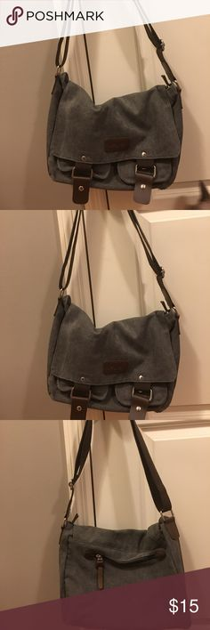 Messenger bag Super cute messenger bag! Darker gray in color with brown accents. Never used. No tags. Bags