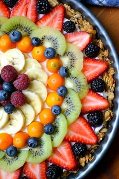 Beautiful Breakfast Tart made with granola crust, yogurt filling, and fresh fruit.