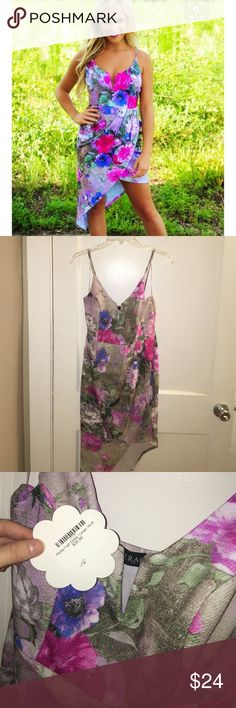 """Floral Asymmetrical Dress Brand new with tags! Never been worn! Originally purchased online from ShopHope's. In perfect condition. The material does stretch. Straps are not adjustable. It has built in padded cups. It runs true to size and is supposed to be a more """"fitted"""" dress. Shop Hope's Dresses Asymmetrical"""