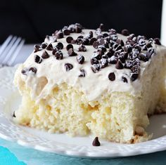 Cannoli Poke Cake - Vanilla cake soaked in sweetened condensed milk, then frosted with an amazing connoli filling. And it's an easy cake mix recipe!