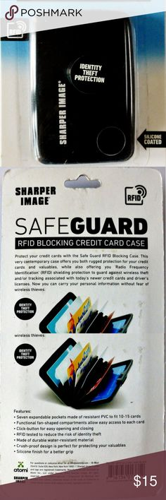 Sharper Image identity theft protection wallet NWT RFID blocking credit card case wallet Click button easy opening & closing Fan shaped compartments for easy access RFID tested to reduce the risk of identity theft Holds up to 15 cards New in package Sharper Image  Accessories Key & Card Holders