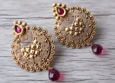 MUST HAVE, antique gold earring with accent red stones and matching bead.  Visit us at www.aavarna.com  Like us on FB: Aavarna  #bridesmaid #indianwedding #wedding #jewelry #bollywood #indianfashion #shaadi #indianbride #hindubride #earrings #forsale #bollywoodfashion #indianfashion #jhumka #fashion #asianbride #onestopweddingshop #bridalwear #kundan #baju #traditional #stunning #instafashion #fashiontrend #aavarna #southindianfashion #tamil #tamilbride #hindubride #aavarnacollections…