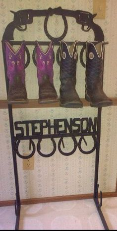 Don't care for the pistols, horse heads would be my choice. But I really like that the boots are hung by the pull on straps and not allowed to slump and ruin the boot top leather