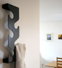 Wave Coat Rack $89.95 (for those 'small, hard to fit anything on' walls near entry points in your house)