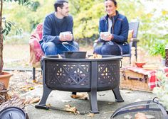 Large steel fire pit with cooking grill included. This fire pit has a Moroccan style pattern which is silhouetted against your fire, this is particularly spectacular at night. The fire pit comes complete with spark guard lid for safety.