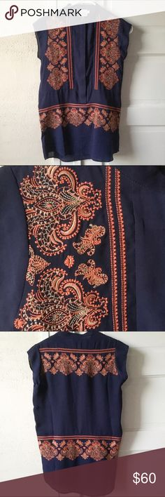 Gorgeous Anthropologie Embroidered Top This is so lovely. Navy with orange and gold embroidery, by HD in Paris. Buttons partway up the front. EUC. Anthropologie Tops Blouses