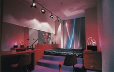"Track lighting, freestanding neon art, reflective mini blinds, purple carpeted step platform bed palmandlaser From ""The International Collection of Interior Design"" 80s Interior Design, 1980s Interior, 80s Design, Interior And Exterior, Interior Decorating, Decorating Ideas, Interior Trim, Cafe Interior, Interior Paint"