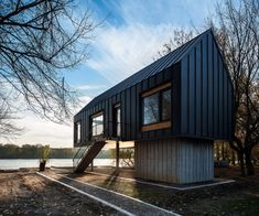 Located in Progar Ada, Serbia, this Small River House, designed by Remorker Architects in is an house, used as a vacation home. A Frame House, Up House, River House, Flooded House, Contemporary Cabin, Woodland House, Modern Barn House, House On Stilts, Backyard House