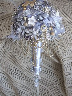 Bridal Brooch Bouquet.   I mixed  vintage with new to create an amazing coloration, texture and movement....