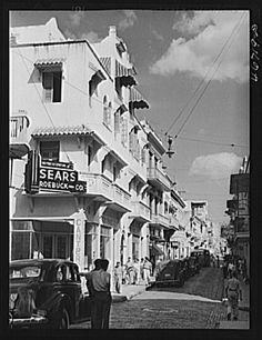 San Juan, Puerto Rico. A street in the shopping district, now days there is or was a Rainbow clothing store.