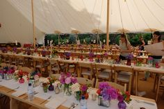 trestle tables decorated with a collection of vases for this fun birthday party