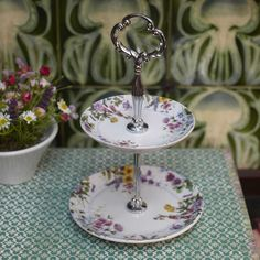 A Victorian-design Bon-bon stand. Smaller in stature than a cake stand, its purpose is to display smaller bonbons or miniature Macaroons on an appropriate scale. Comes completed with presentation box. Dimensions: H x W Victorian Design, Macaroons, Chic, Orchids, Purpose, Scale, Presentation, Miniatures, Display