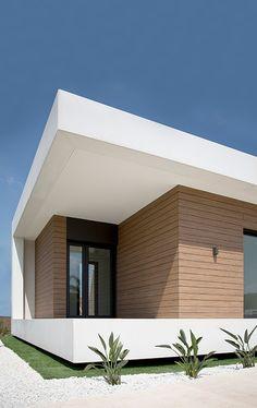Vivienda unifamiliar en Torre en Conill, Bétera. Valencia. Casa de lujo, hormigón, trespa, GRC, casa moderna, cubierta inclinada, madera, hormigón y madera, fachada de trespa.