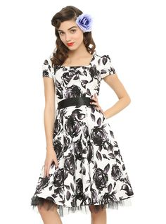 "<p>White dress with a black floral print, black satin waistband tie, bow-accented sweatheart neckline, tulle underlay and elastic cap sleeves. Side zipper closure.</p>  <ul> 	<li>39"" long from the shoulder</li> 	<li>97% cotton; 3% spandex</li> 	<li>Wash cold; dry flat</li> 	<li>Imported</li> </ul>"