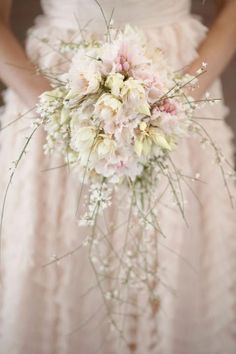 """A Spring Soiree / Wedding Style Inspiration / LANE / Soft whimsical mismatched flowers with a pastel tone. The theme of the floral arrangements at my enchanted forest wedding is """"wildflowers"""". The light and delicate flowers contain a dream-like quality"""