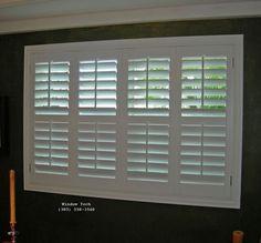 White bi-fold window shutters