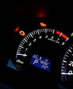closeup photo of modern car tachometer on black background night
