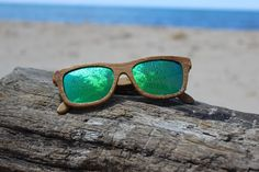 Carbonized Natural Bamboo, with high-quality green mirrored lenses. Two-way hinged arms. Pretty cool, eh? We sure think so.