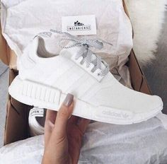 hot sales f723f 061aa All white women s Adidas NMD s sneakers. At TheShoeCosmetics all white  trainers are the canvas, the fresh face to a sneaker makeover.
