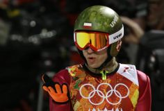 Polands Kamil Stoch blows a kiss after his first attempt during the mens normal hill ski jumping f Ski Jumping, Olympians, Olympic Games, Bicycle Helmet, Skiing, Athlete, Kiss, Jumpers, Restaurant