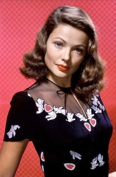 Hollywood princess Gene Tierney portrait glam vintage fashion icon movie star black blouse shirt top sheer bow red hearts cherubs white novelty print appliqué