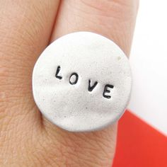 $10 Simple Love Letters Stamped Round Hammered Ring in Silver