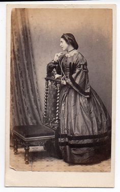 CRINOLINE LADY POSING BY A CHAIR  1860s UK