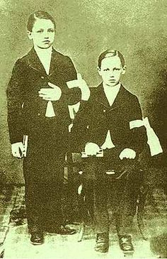 Arthur Rimbaud and his brother Frederic at their first communion.