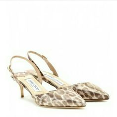 """Jimmy Choo Tarida Leopard-Print Slingback Pump Shimmery leopard-print leather points the way on this Jimmy Choo slingback pump.  Jimmy Choo leopard-print leather pump. 2"""" lacquered metallic heel. Pointed toe; low-cut vamp. Adjustable slingback strap. Leather lining and sole. """"Tarida"""" is made in Italy.  Sizing note:?Jimmy Choo runs small. We suggest that you order a half size larger than you typically wear. Jimmy Choo Shoes Heels"""