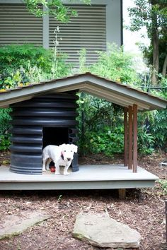 Dog House using recycled drainage pipe & wood with green roof by Heather Garrett Design.