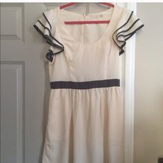 Anthropologie Dress Very cute cream and grey dress. Anthropologie Dresses Midi