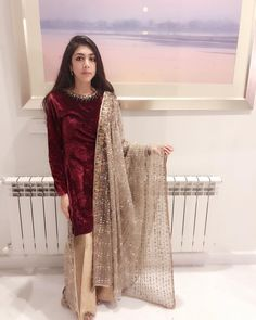 looks gorgeous in this deep red velvet shirt with jewelled detailing, paired against an entirely handworked dupatta from the collection. Pakistani Fashion Party Wear, Pakistani Wedding Outfits, Indian Fashion Dresses, Indian Designer Outfits, Designer Dresses, Designer Wear, Beautiful Pakistani Dresses, Pakistani Formal Dresses, Pakistani Dress Design