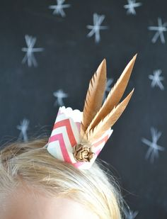 DIY party hats using cupcake liners and kraft paper feathers...I know, right?! {Jacks & Kate}