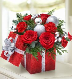 All Wrapped Up™ for the Holidays Send a holiday present with real presence: a fresh bouquet of red roses, white lilies, hypericum and assorted fragrant Christmas greens. Description from pinterest.com. I searched for this on bing.com/images