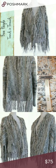 Free People Fringe Sweater Wool Blend Medium Free People Fringe Cardigan Sweater, Women's Size Medium M, Pre-Owned in Excellent Condition.  Features:  Very warm sweater in a medium knit made of 25 percent wool, 66 percent acrylic, 9 percent alpaca and other fibers, knitted in multi-colored grays and whites. Hand wash.  Thick, long fringe detail, asymmetric hem, long sleeves, no button or zipper closure. Free People Sweaters Cardigans