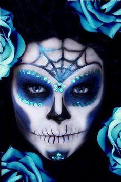 dia de los muertos makeup, love how the spider web follows curve of her eyebrows