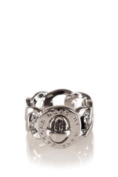 Marc by Marc Jacobs signature turnlock ring with logo engraving.  95% Tin Alloy 5% Brass. Imported.