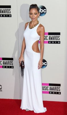"The Biggest Fashion Moments at the American Music Awards: Lately, Nicole Richie has been stepping out in a lot of outfits that look very ""yacht party in the south of France."" This white number is no exception. It walks that fine line of being utterly glamorous and totally tacky all at once, which is kind of a fashion magic trick."