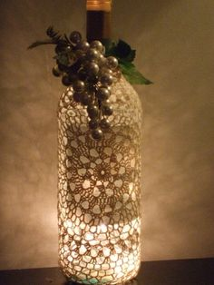 Turn a wine bottle into a lighting accent – After the Party: 5 Ways to Upcycle Wine Bottles @ DIY Home Ideas