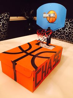 Basketball Valentine box. Used orange shoe box, electric tape, and small goal purchased at dollar store.