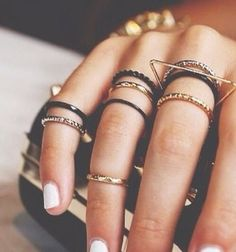 black and gold ring stacks