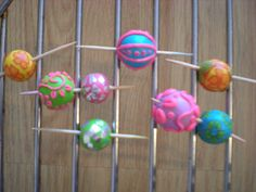 Cheap polymer clay beads are filled with aluminum foil before baking.