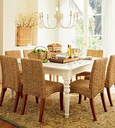 trying to figure out my personal home decor style... like the combo of seagrass chairs with ivory table...pretty simple chandelier