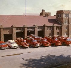 """The Red Deer Fire Department in their """"new"""" fire hall., 1962 The building is now the Children's Library of the downtown branch of the Public Library. The white vehicle is the first City-run ambulance. Red Deer, AB"""