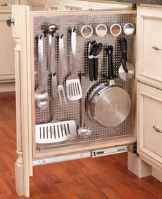 Make the best of Skinny Spaces: In a small kitchen with little storage space, you can make even narrow filler spaces work harder by installing a vertical pegboard rollout. Shown is the 434 Series 6-in. Base Filler with stainless steel panel, about $315, f