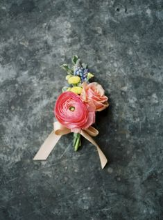 Ranunculus and rose boutonniere: http://www.stylemepretty.com/little-black-book-blog/2015/05/20/sweet-rustic-spring-bloom-wedding-inspiration/ | Photography: Jake Anderson - http://jakeandersonphoto.com/