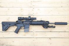 Systema TW M4 with Trijicon AccuPoint TR24G Scope. Airsoft gun in Japan. Fashion Photo