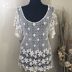 Crochet Top NWT pretty crochet top is perfect over your favorite cami or to wear as a cover up over you bathing suit. ROOMMATES Tops