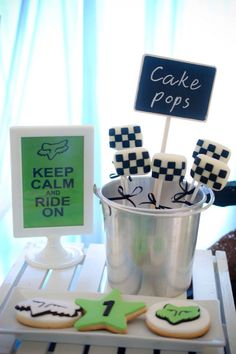 Dirt Bike Themed Dessert Table Event: Thirdy's 1st Birthday Venue Set-up: Mychoice Party Shop Dessert Table Set-up|Cake|Cupcakes|Cookies: Sweet PEA by Genesis Sison-Basiao Cakepops: The Cakeroom Photos: Bacolod Click & Smile Photobooth
