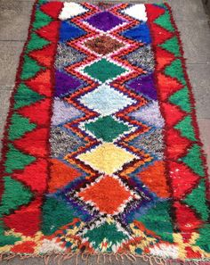 Lovely vintage Boucherouite rug....sourced from Morocco  It would look great on a floor in any room, or hanging on a wall  The Moroccan Boucherouite rugs, or rag rugs as we know them are made from a mixture of recycled fabrics that are cut into long strips and then hand knotted to create a colourful and artistic, often crazy design. They are sometimes described as Picasso rugs because of their artistic nature.  This particular rug is made from hand dyed cotton knotted into a backing of…